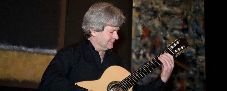 Rick playing classical guitar