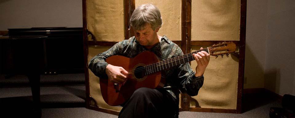 Ricks playing classical guitar